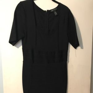 Black bodycon dress. Square neckline